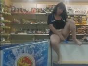 The clerk at the counter masturbates