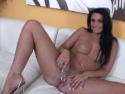 Lusty brunette plays soslo with a fuck toy