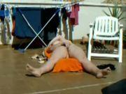 My mum sunbathing in terrace decided to masturbate.