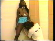 Black chick with big tits is fucked by nerdy cop and black detective in jail