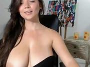 Young webcam girl plays with her huge breasts