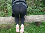 mature outside in leggings and shoes