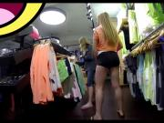 Blonde with sexy pair of legs and short pants shoping