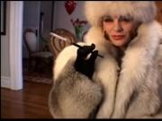 Smoking in fur coat