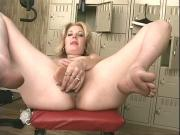 Horny blonde girl exercises naked in a locker room