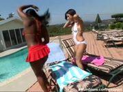 Open-air interracial lesbian sex under the hot sun