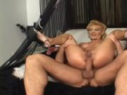 Blonde milf takes it in both holes