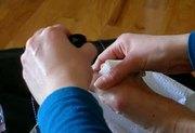 Wife painting her toenails (grey nail polish)