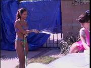 Two Playful Girls Wash the Car and Give