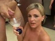 Blonde collects cum in a wine glass