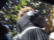 Short Hair Woman In A Short Black Skirt