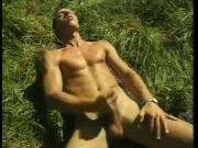 Guy massaging wang in the forest