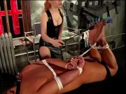 Big tits mistress playing with her bound slave
