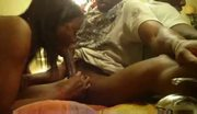 Ebony gal works on his massive cock with enthusiasm