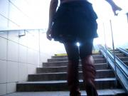 Girl in black stockings & red high boots going upstairs 1