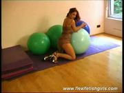 Busty flexible girl spreading her legs and squizing