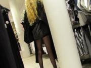 Skinny blonde in black nylons at H & M.