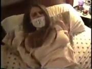 Gagtalking girl in the bedroom