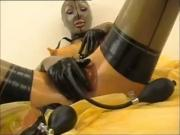 Rubber Lady with dildo + Masturbation and Latex