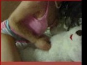 latin girl play whit her teddy bear