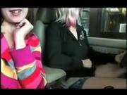 Two girls flash at fast food drive through