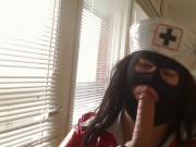 Nurse sucking dildo