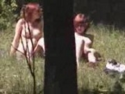 Nudist girls in a forest