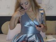 Sexy MILF spits on her silver satin dress