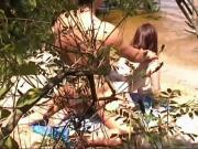 Nudist spy behind a plant