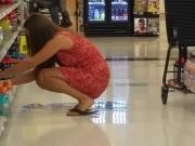 Hot milf in dress at grocery voyeur