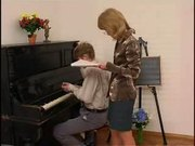 A sexy piano-teacher and her student