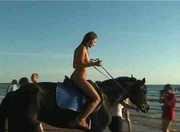 Vika nude riding on public beach