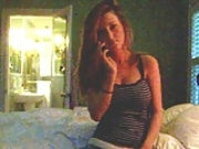 Busty girl talks to boyfriend on phone and strips