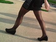 Sexy legs in miniskirt and black pantyhose candid
