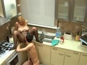 Husband cheats with maid in the kitchen