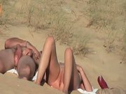 Voyeur couple in beach