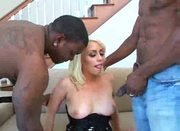 She desires to milk these two black rods