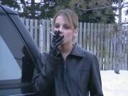Smoking Girl in Leather Jacket and Gloves 2