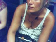 downblouse braless in Paris subway