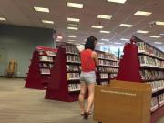 Japanese babe's sweet ass in library