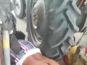 friends wife near Tractor tyre hidden