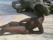Cute ebony girl having fun on beach