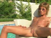 skinny blonde girl at poolside