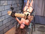 Hot brunette on bondage table takes pain