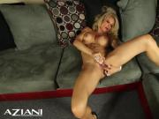 Fit MILF strips and fingers her pussy and rubs her big clit