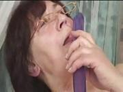 Hairy granny in Glasses Dildos Spreads Sucks and Fucks