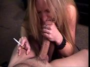 Horny blonde massages the tip of a thick cock with her lips