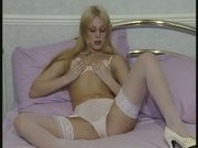British slut Emma P plays with herself on the bed