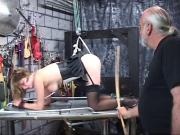Blond puma restrained and cained on a bondage table