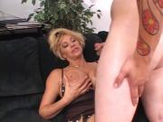 Lusty blond mature deep throats a long hard white cock